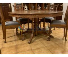 Teak round dining table with 8 teak chairs