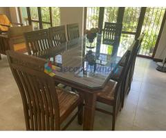 Wooden dining table with glass top (8-seater)